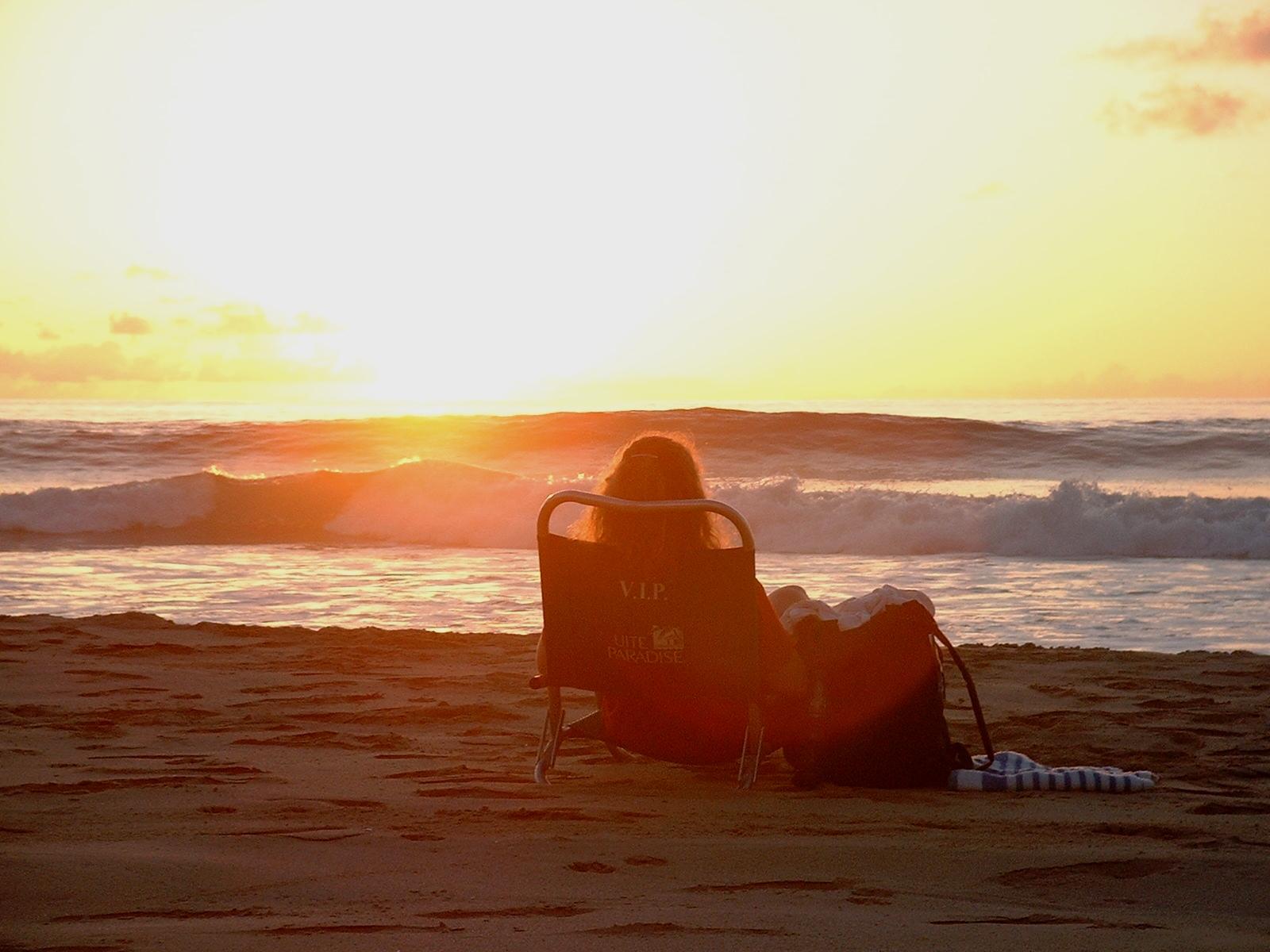 woman at Polihale beach at sunset